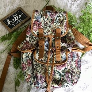 Tapestry and leather backpack